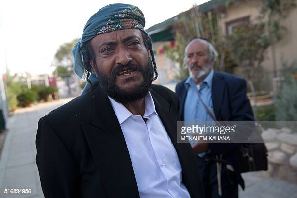 Yemeni Jew Sliman Ychya Yakov Dahari gestures as he arrives at an immigration centre in the Israeli city of Beersheba on March 21 2016 following a...