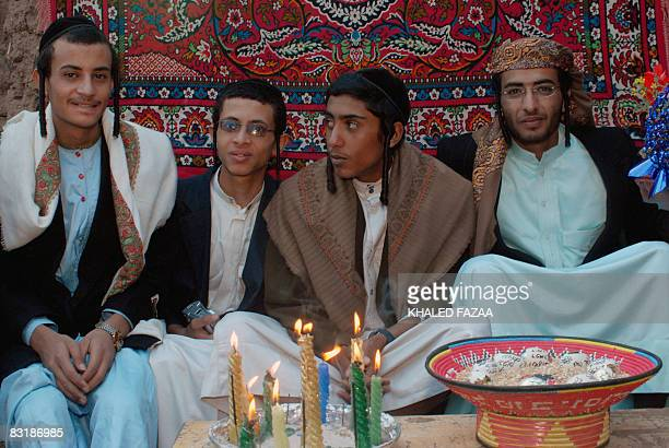 Yemeni Jew Yussef Saeed Hamdi poses for a picture with unidentified guests on the first day of his traditional wedding party in the village of Raydah...