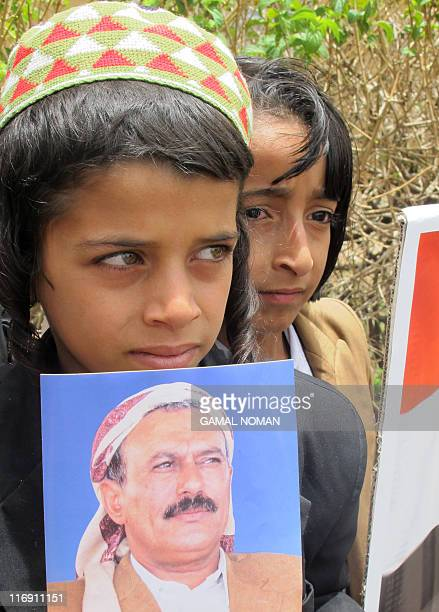 A Yemeni Jewish boy holds a photo of embattled President Ali Abdullah Saleh during a rally outside the US embassy in the capital Sanaa on May 3 to...