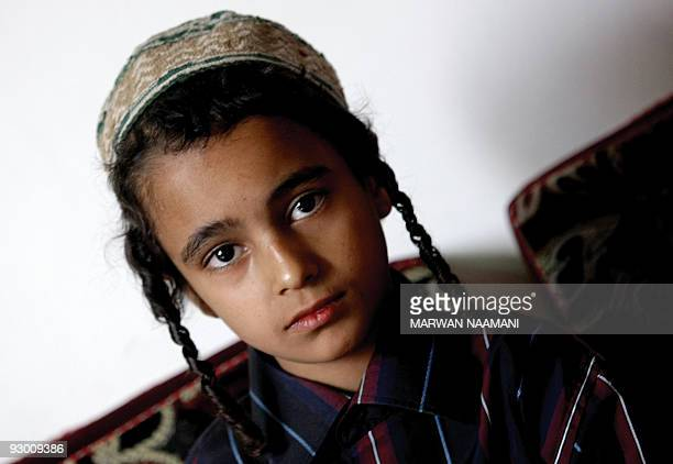 Yemeni Jewish boy Jamil sits in an apartment in Sanaa on November 10 2009 that was given to his family by the Yemeni government after fleeing from...