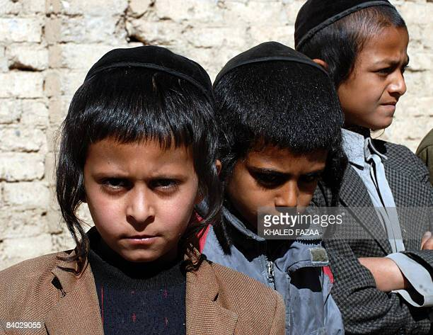Yemeni Jewish boys stand outside the Shabazi Hebrew school in the village of Raydah in Amran province 70 kilometres north of the capital Sanaa on...
