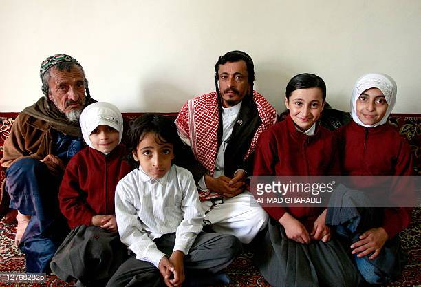 Yemeni Jewish Rabbi Yahia Yussef Mussa sporting a chequerred Keffiya poses for a picture with his father Rabbi Yussef his daughters and other...