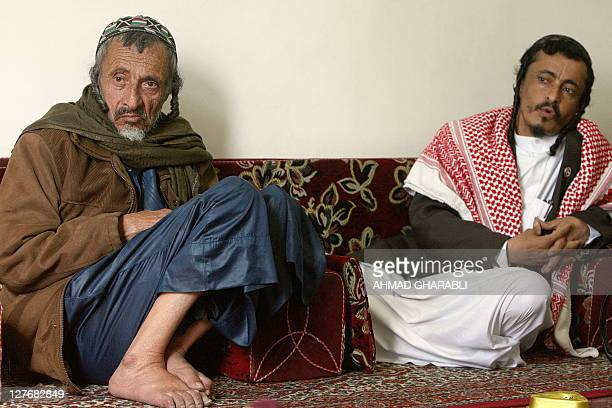 Yemeni Jewish Rabbi Yahia Yussef Mussa sporting a chequerred Keffiya poses for a picture with his father Rabbi Yussef at his apartment in the Yemeni...