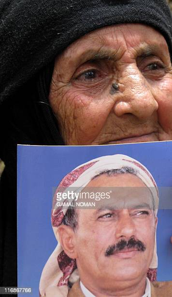 A Yemeni Jewish woman holds a photo of embattled President Ali Abdullah Saleh during a rally outside the US embassy in the capital Sanaa on May 3 to...