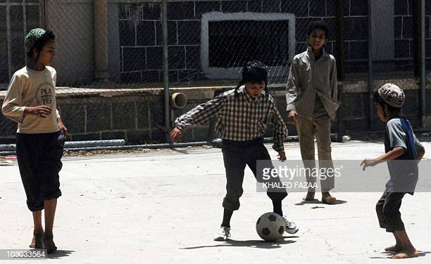 Yemeni Jewish youths play football at their temporary residence in the tourist city hotel compound in Sanaa on June 23 2008 Some 45 Yemeni Jews were...