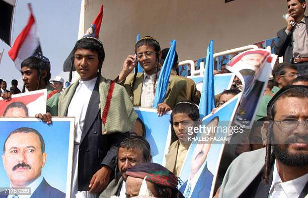 Yemeni jews hold pictures of Yemeni President Ali Abdullah Saleh during an electoral rally in Amran 65 kms north of Sanaa 31 August 2006 in the...