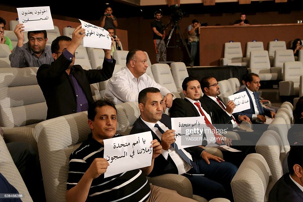 Yemeni journalists hold placards to support their colleagues jailed in Shiite Huthi rebels prisons in Yemen during a press conference of the United Nations Special Envoy to Yemen on May 5, 2016 at the information ministry in Kuwait City. The head of the Yemeni government delegation at troubled peace talks in Kuwait demanded action from UN mediators over rebel shelling of besieged third city Taez. ZAYYAT