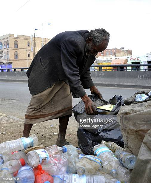 Yemeni man collects garbages to recycle to earn money is seen inside dumps in Sanaa Yemen on February 14 2015 UNICEF had announced that 147 million...