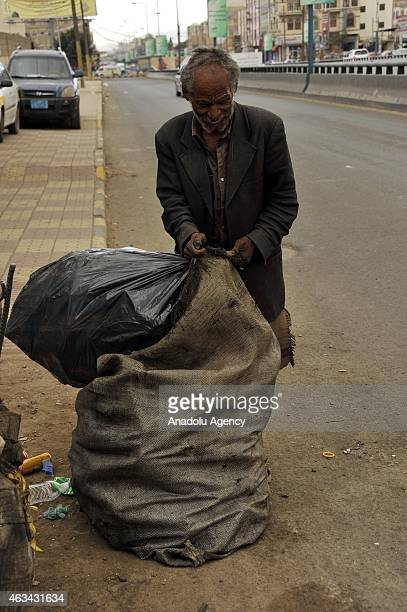 Yemeni man collects garbages to recycle to earn money is seen with dumps in Sanaa Yemen on February 14 2015 UNICEF had announced that 147 million of...
