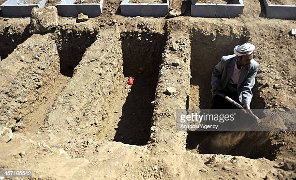 A Yemeni man digs a grave for a soldier killed in Hadramawt by an attack held by Ansar alSharia Yemenbased umbrella organization of AlQaeda at...