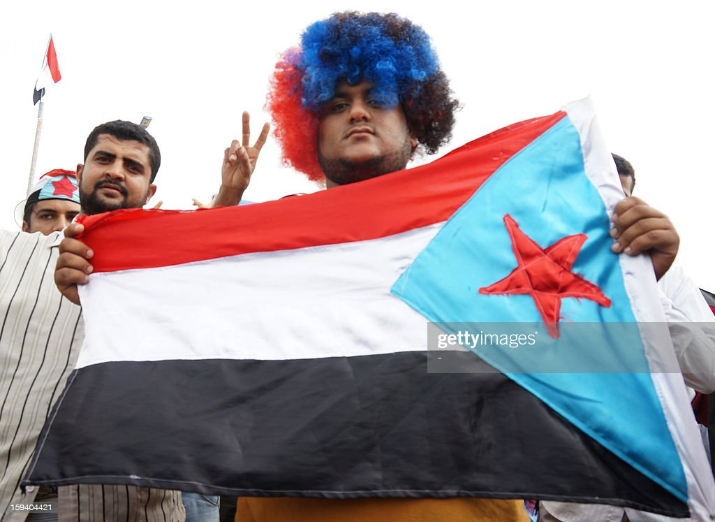 A Yemeni man holds up the former People's Democratic Republic of Yemen flag, as thousands of pro-secession Southern Movement and several other separatist factions rallied in the southern port city of Aden on January 13, 2013, calling for the independence of the south on the 27th anniversary of civil war. North Yemen (Yemen Arab Republic) and South Yemen (People's Democratic Republic of Yemen) unified in 1990 to form the present day republic.