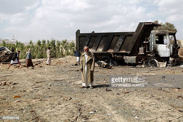 A Yemeni man inspects the damage at a site reportedly hit by Saudiled airstrikes in the capital Sanaa on January 6 2016 Nearly 6000 people have been...