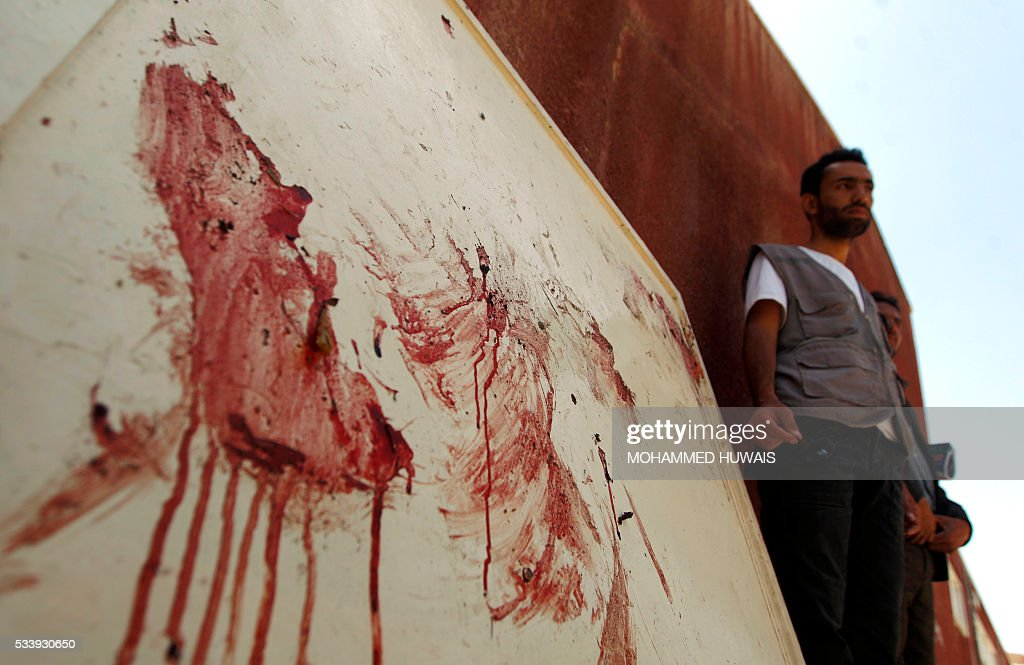 A Yemeni man stands next to blood stains at the scene of a bomb attack at a university campus in the capital Sanaa, on May 24, 2016. A bomb hit a university campus in the rebel-held Yemeni capital Sanaa killing two people at an event commemorating the country's 1990 unification, a security official said. The event was organised by the Huthi Shiite rebels who have controlled the capital since September 2014 despite a 14-month-old Saudi-led military intervention in support of President Abedrabbo Mansour Hadi. / AFP / MOHAMMED