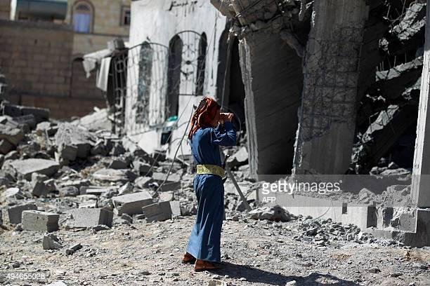 A Yemeni man stands next to the ruins of buildings destroyed in an airstrike by the Saudiled coalition in the capital Sanaa on October 28 2015 AFP...