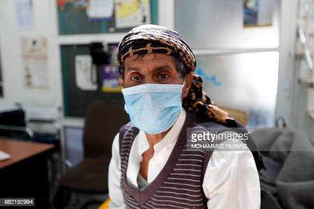A Yemeni man suspected of being infected with cholera receives treatment at a hospital in Sanaa on May 12 2017 / AFP PHOTO