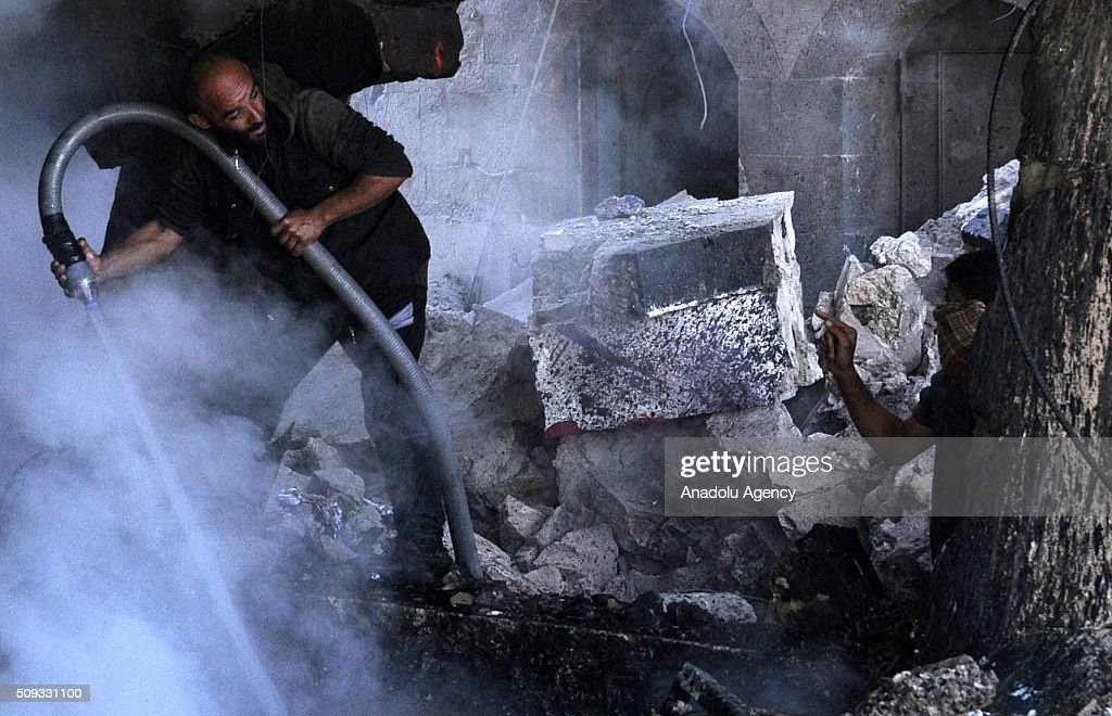 A Yemeni man tries to extinguish fire after the war crafts belonging to the Saudi-led coalition carried out airstrikes at Beit al-Miad district of Sanaa, Yemen on February 10, 2016.