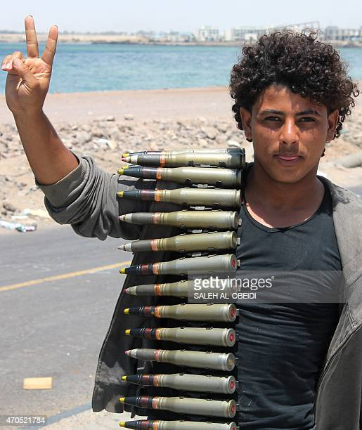 A Yemeni member of the southern separatist movement allied to fugitive President Abedrabbo Mansour Hadi carries ammunition on his shoulder and...