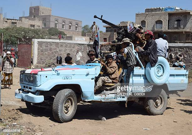 Yemeni members of the southern separatist movement loyal to the Yemeni President Abedrabbo Mansour Hadi patrol a street as they secure the venue of a...