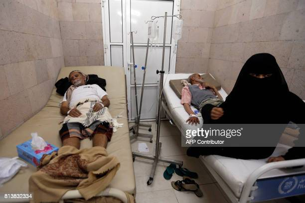 Yemeni men suspected of being infected with cholera receive treatment at a makeshift hospital in Sanaa on July 13 2017 More than 320000 suspected...
