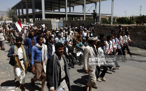 Yemeni men take part in a 'protest for bread' march from the capital Sanaa to the coastal town of Hodeida on April 19 demanding an end to the war...