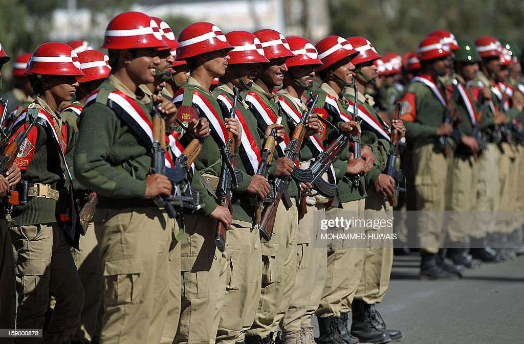 Yemeni Military Police stand to attention during a ceremony to inaugurate the first phase of combat and operational training for 2013 in the Yemeni capital Sanaa, on January 5, 2013.