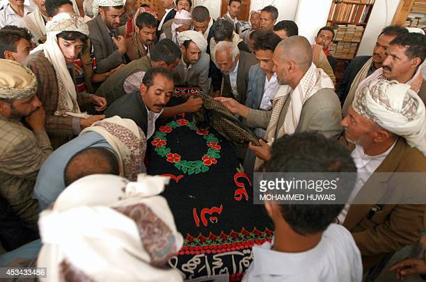 Yemeni mourners carry the coffin of a soldier who was killed by alQaeda militants in the southeastern province of Hadramawt during his funeral on...