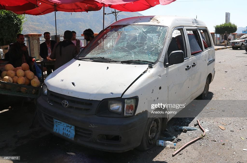 Yemeni people inspect the site of a car bomb attack in Ibb, Yemen on November 01, 2015.