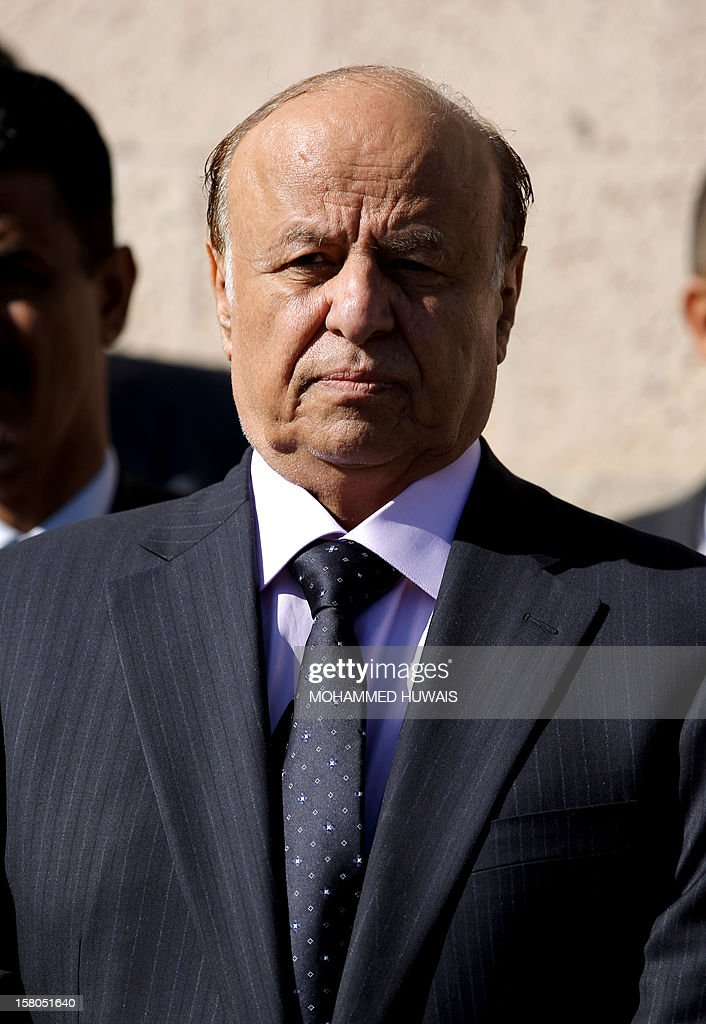 Yemeni President Abd Rabbo Mansour Hadi attends the funeral procession in Sanaa of military officers who were killed in an ambush attack earlier in the week, on December 10, 2012. Four officers, including General Nasser Naji bin Farid, commander of military forces in central Yemen, were killed and six soldiers wounded in the attack by armed men on December 8, near Marib, 140 kilometres east of Sanaa, blamed on Al-Qaeda.