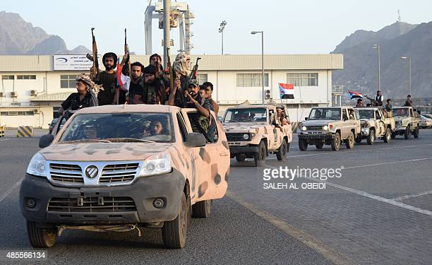 Yemeni progovernment forces loyal to exiled Yemeni President Abedrabbo Mansour Hadi sit in the back of vehicles in the city of Aden on August 28 2015...