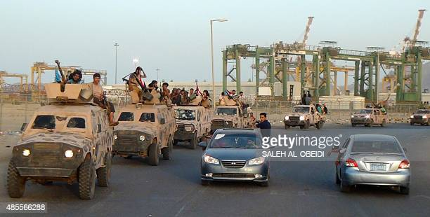 Yemeni progovernment forces loyal to exiled Yemeni President Abedrabbo Mansour Hadi drive in the streets of the city of Aden on August 28 2015 The...