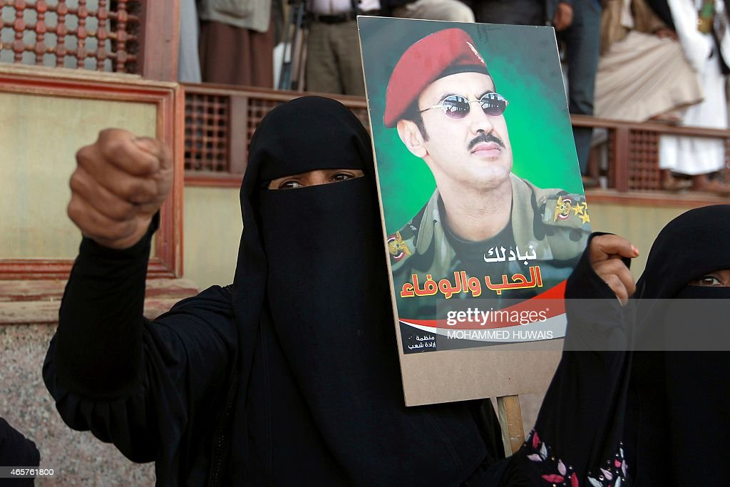 A Yemeni protester holds a portrait of Ahmed <a gi-track='captionPersonalityLinkClicked' href=/galleries/search?phrase=Ali+Abdullah+Saleh&family=editorial&specificpeople=221711 ng-click='$event.stopPropagation()'>Ali Abdullah Saleh</a>, the son of Yemen's former president <a gi-track='captionPersonalityLinkClicked' href=/galleries/search?phrase=Ali+Abdullah+Saleh&family=editorial&specificpeople=221711 ng-click='$event.stopPropagation()'>Ali Abdullah Saleh</a> who stepped down in early 2012, during a demonstration demanding him to rule the country, on March 10, 2015 in the capital Sanaa.
