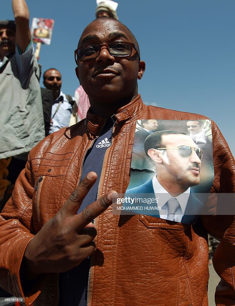 A Yemeni protester takes part in a demonstration in the capital Sanaa on March 10, 2015, demanding Ahmed <a gi-track='captionPersonalityLinkClicked' href=/galleries/search?phrase=Ali+Abdullah+Saleh&family=editorial&specificpeople=221711 ng-click='$event.stopPropagation()'>Ali Abdullah Saleh</a>, the son of Yemen's former president <a gi-track='captionPersonalityLinkClicked' href=/galleries/search?phrase=Ali+Abdullah+Saleh&family=editorial&specificpeople=221711 ng-click='$event.stopPropagation()'>Ali Abdullah Saleh</a> who stepped down in early 2012, to rule the country. AFP PHOTO / MOHAMMED HUWAIS