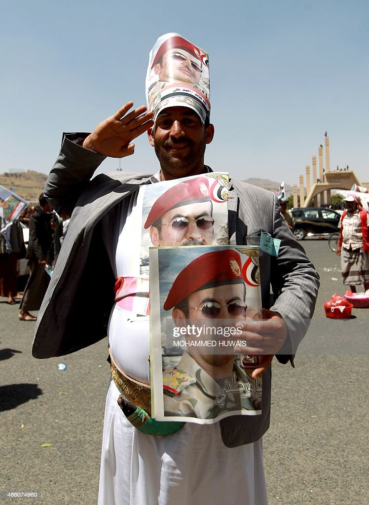 A Yemeni protester takes part in a demonstration in Yemen's militia-controlled capital, Sanaa, calling for presidential elections and for Ahmed <a gi-track='captionPersonalityLinkClicked' href=/galleries/search?phrase=Ali+Abdullah+Saleh&family=editorial&specificpeople=221711 ng-click='$event.stopPropagation()'>Ali Abdullah Saleh</a> (portrait), the son of Yemen's former president <a gi-track='captionPersonalityLinkClicked' href=/galleries/search?phrase=Ali+Abdullah+Saleh&family=editorial&specificpeople=221711 ng-click='$event.stopPropagation()'>Ali Abdullah Saleh</a> who stepped down in early 2012, to run as a candidate, on March 13, 2015. AFP PHOTO / MOHAMMED HUWAIS