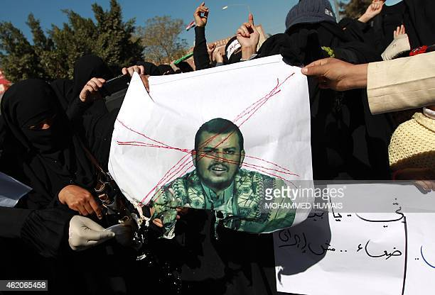 Yemeni protesters burn a portrait of Shiite Huthi movement's leader AbdulMalik alHuthi during a rally against the control of the capital by Huthi...