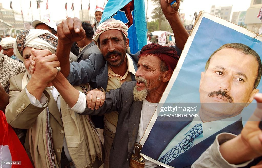 Yemeni protesters hold a portrait of Yemen's former president <a gi-track='captionPersonalityLinkClicked' href=/galleries/search?phrase=Ali+Abdullah+Saleh&family=editorial&specificpeople=221711 ng-click='$event.stopPropagation()'>Ali Abdullah Saleh</a> during a demonstration against airstrikes carried out by the Saudi-led Arab coalition against Huthi militia in the capital Sanaa on April 3, 2015.