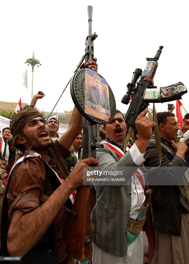 Yemeni protesters hold rifels with portraits of Yemen's former president <a gi-track='captionPersonalityLinkClicked' href=/galleries/search?phrase=Ali+Abdullah+Saleh&family=editorial&specificpeople=221711 ng-click='$event.stopPropagation()'>Ali Abdullah Saleh</a> hung on them during a demonstration against airstrikes carried out by the Saudi-led Arab coalition against Huthi militia in the capital Sanaa on April 3, 2015.
