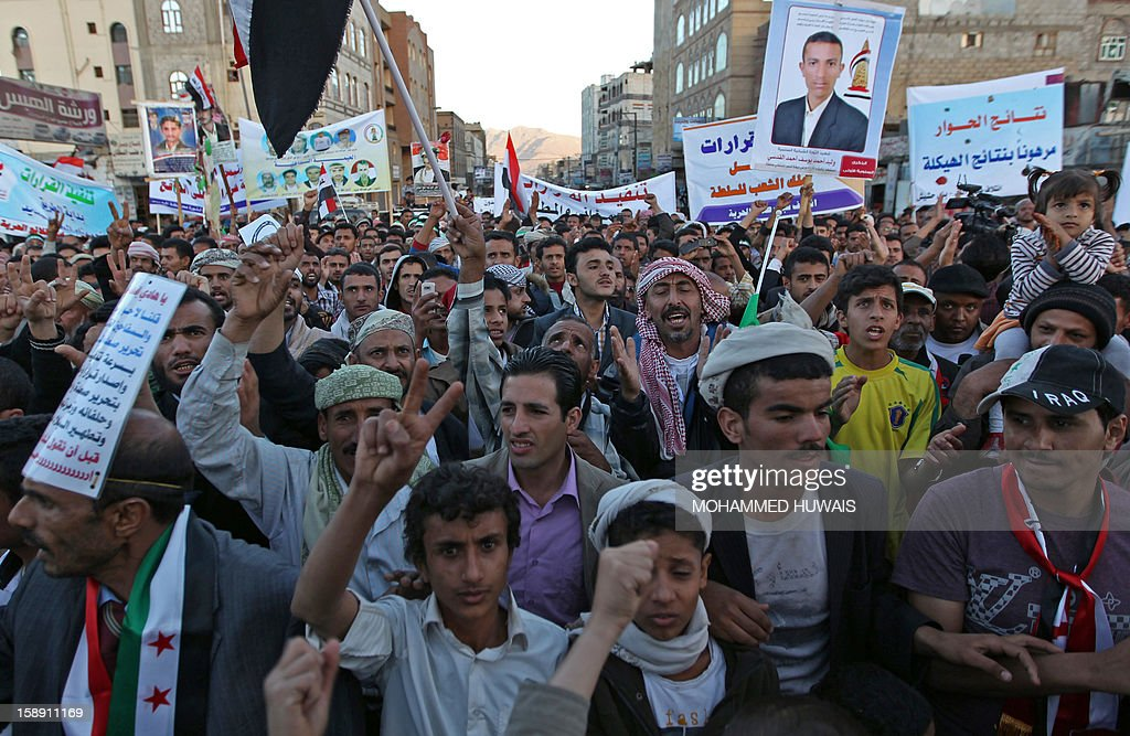 Yemeni protestors shout slogans and wave banners during a demonstration in Sanaa on January 3, 2013, demanding for a quicker implementation of President Abdrabuh Mansur Hadi's latest orders to restructure Yemen's military.