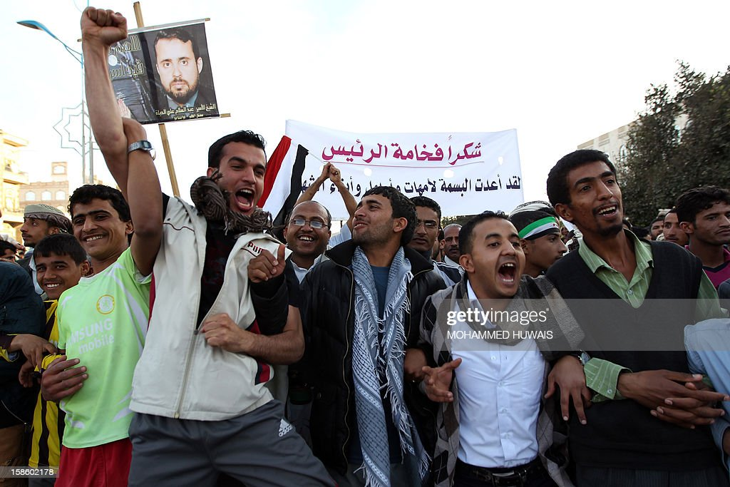 Yemeni protestors shout slogans during a demonstration in Sanaa on December 20, 2012, in support of President Abdrabuh Mansur Hadi's decision to restructure Yemen's military. Hadi has dramatically restructured Yemen's military to curb the influence of those linked to toppled strongman Abdullah Ali Saleh with the strong backing of Yemen's Gulf neighbours.