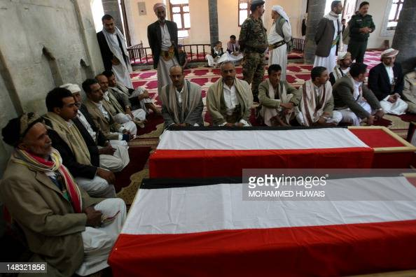 Yemeni relatives of nine police cadets who were killed when an AlQaeda suicide bomber blew himself up at the entrance of a police academy sit near...