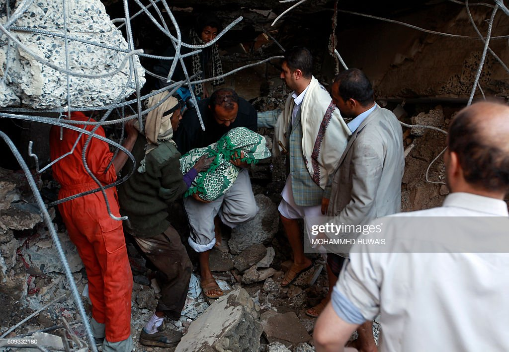 Yemeni rescuers carry the body of a baby girl who was retrieved from the rubble of their home after the building was struck overnight by Saudi-led coalition air strikes on February 10, 2016 in the capital Sanaa. Five members of the same family were killed the strike hit their home in Yemen's rebel-held capital rescuers and neighbours said. HUWAIS