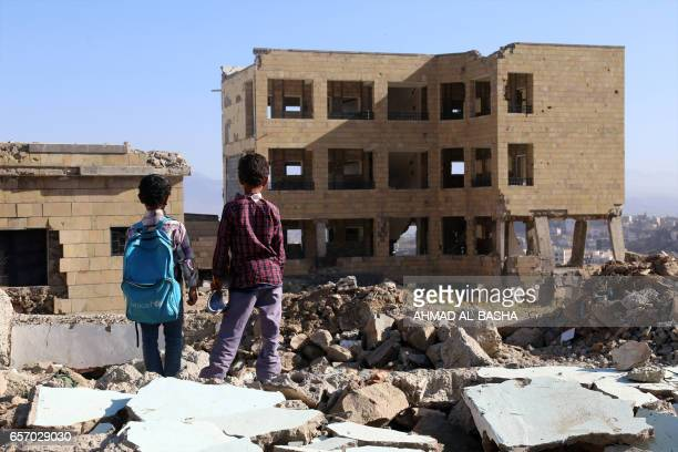 Yemeni school children looks at a school on March 16 that was damaged in an air strike in the southern Yemeni city of Taez The conflict in Yemen...