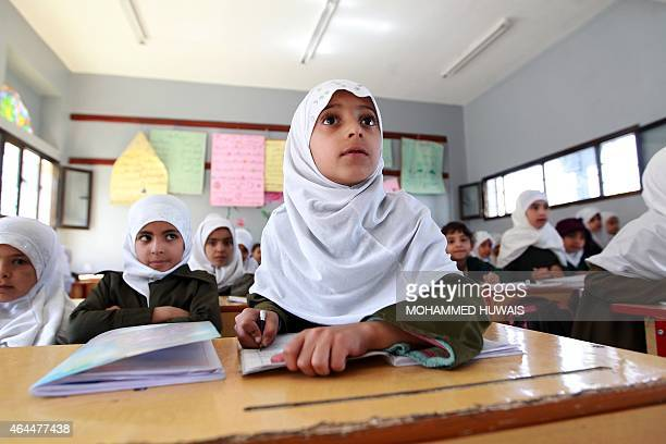 Yemeni schoolgirls attend a class on February 26 2015 in the capital Sanaa Yemen long on the front line in the fight against AlQaeda has been wracked...