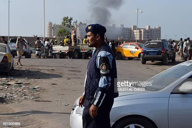 Yemeni security forces patrol after Sheikh bin Farid palace used as a base by the Saudiled coalition forces was hit by a rocket attack on October 6...