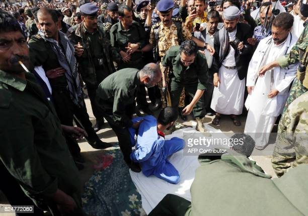 Yemeni security forces prepare to execute a man convicted of raping and murdering a threeyearold girl in the Yemeni capital Sanaa's Tahrir Square on...