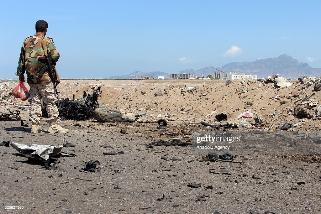 Yemeni security forces stand guard around the scene of a blast after unidentified gunmen staged an attack to the convoy of Aden Chief of Police at the Al-Mansoura region in Aden, Yemen on May 1, 2016.