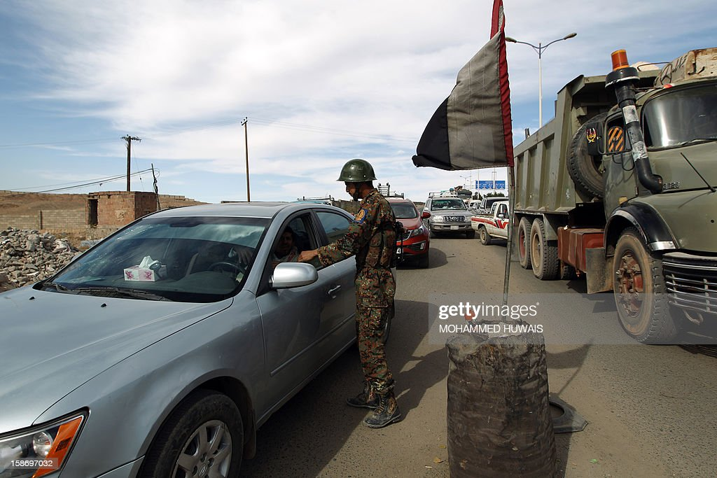 A Yemeni soldier mans a checkpoint at an entrance to the capital Sanaa on December 24, 2012, following the kidnapping of three foreigners. The three hostages -- an Austrian man, a Finnish man and a Finnish woman -- were abducted when they were preparing to travel to the southern port of Aden via second city of Taez on December 21. AFP PHOTO/ MOHAMMED HUWAIS