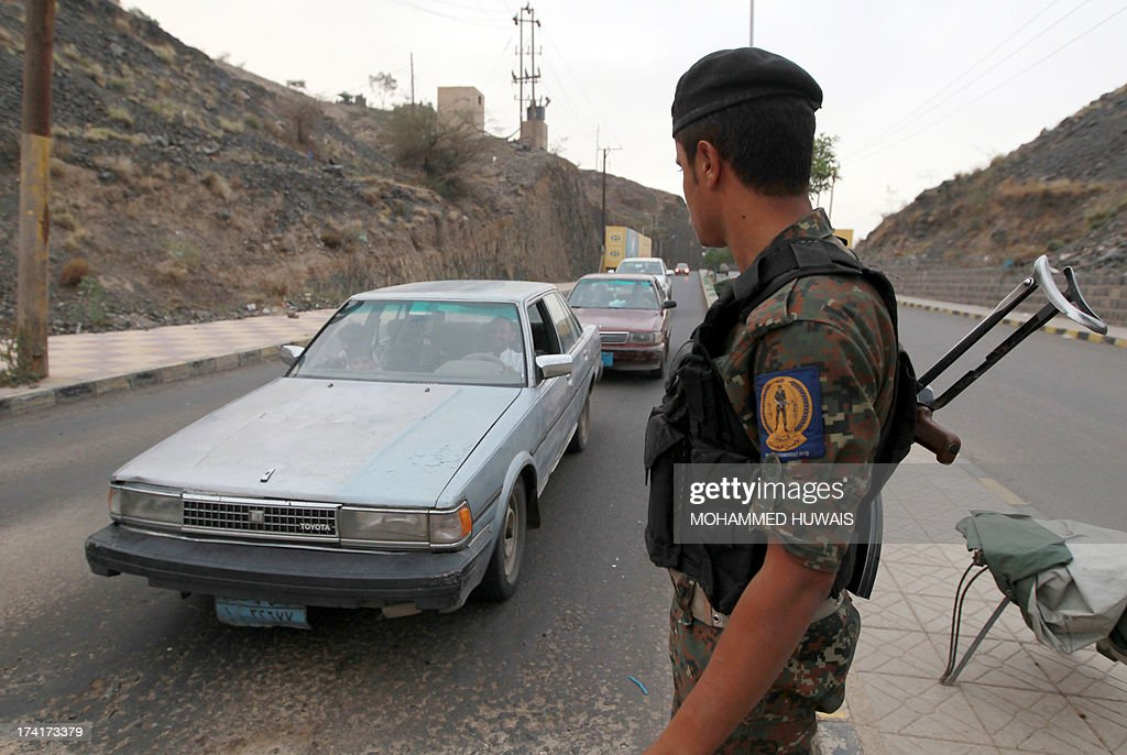 A Yemeni soldier mans a checkpoint in Sanaa, on July 21, 2013, as authorities tighten security measures after gunmen suspected of being members of Al-Qaeda kidnapped an Iranian diplomat in broad daylight in the Yemeni capital, according to police.