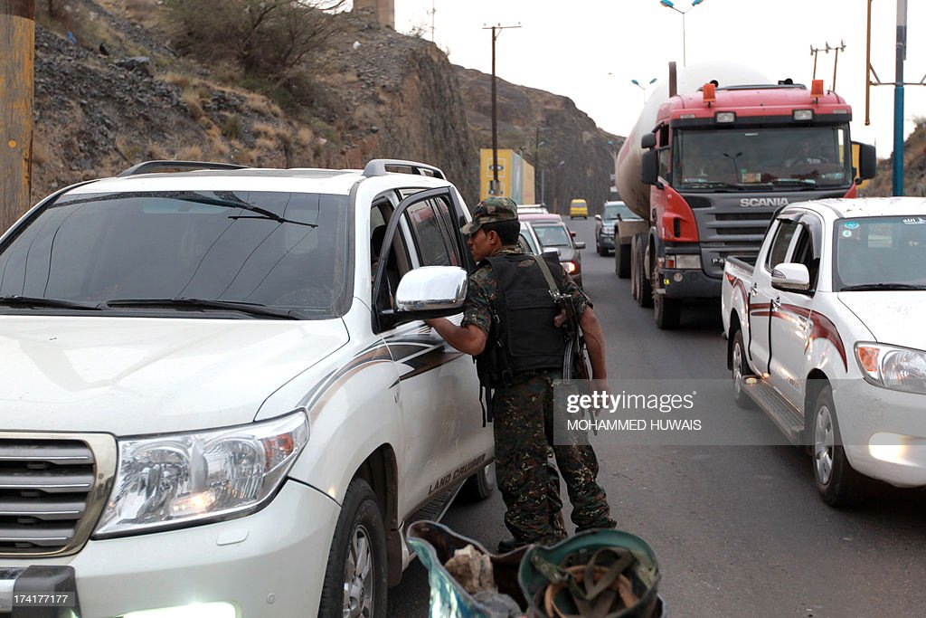 A Yemeni soldier searches a car at a checkpoint in Sanaa, on July 21, 2013, as authorities tighten security measures after gunmen suspected of being members of Al-Qaeda kidnapped an Iranian diplomat in broad daylight in the Yemeni capital, according to police.