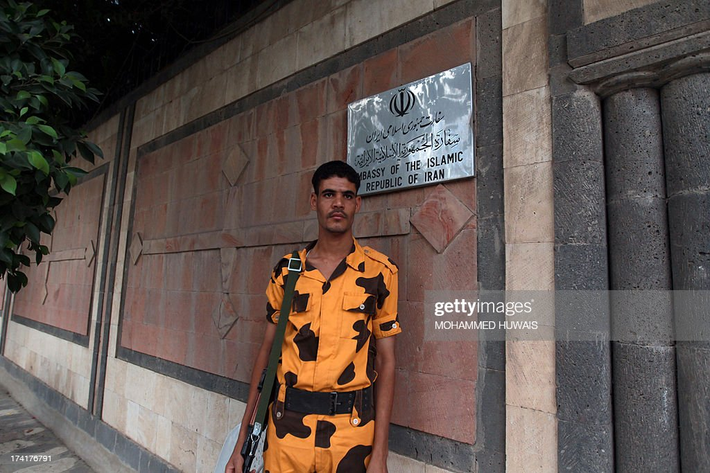 A Yemeni soldier stands guard in front of the Iranian embassy in Sanaa, on July 21, 2013, as authorities tighten security measures after gunmen suspected of being members of Al-Qaeda kidnapped an Iranian diplomat in broad daylight in the Yemeni capital, according to police.