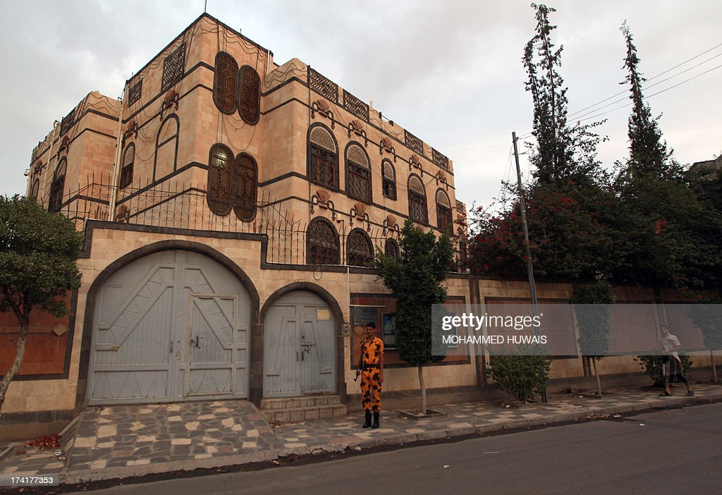 A Yemeni soldier stands guard in front of the Iranian embassy in Sanaa, on July 21, 2013, as authorities tighten security measures after gunmen suspected of being members of Al-Qaeda kidnapped an Iranian diplomat in broad daylight in the Yemeni capital, according to police. AFP PHOTO/ MOHAMMED HUWAIS